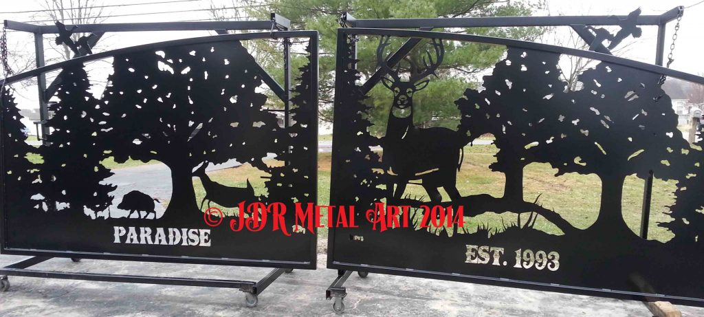 Custom driveway gate with plasma cut wildlife silhouettes for Louisiana entrance by JDR Metal Art.
