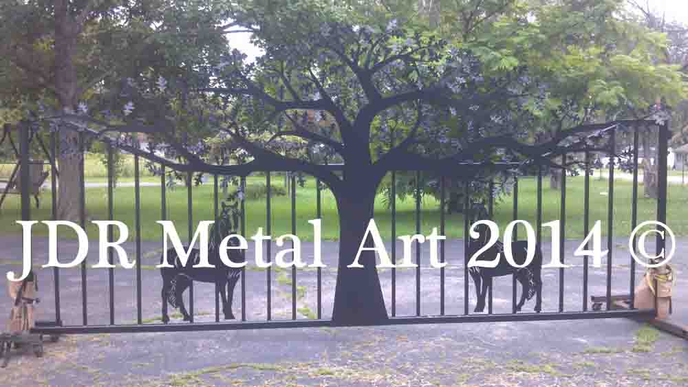 Driveway gate with plasma cut tree and horse design made into metal art.