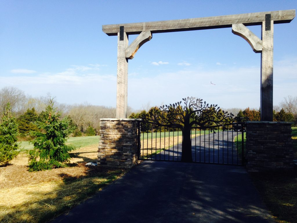 Oak tree themed driveway gates at St Louis Missouri residential entry.