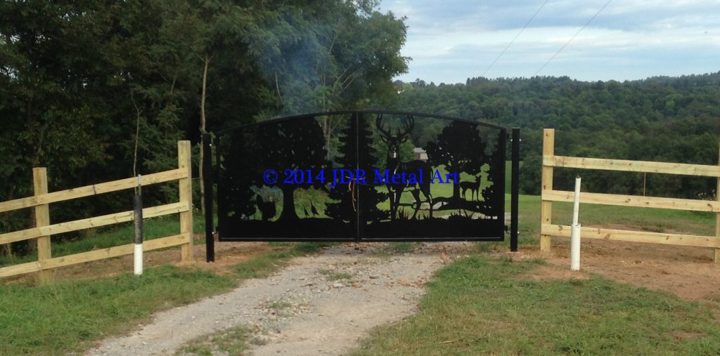 Artistic farm gate in West Virginia featuring deer and turkey silhouettes plasma cut by JDR Metal Art.