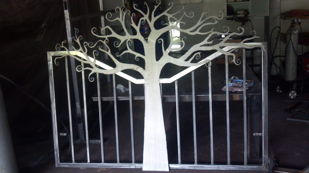 Headboard featuring plasma cut metal art tree design