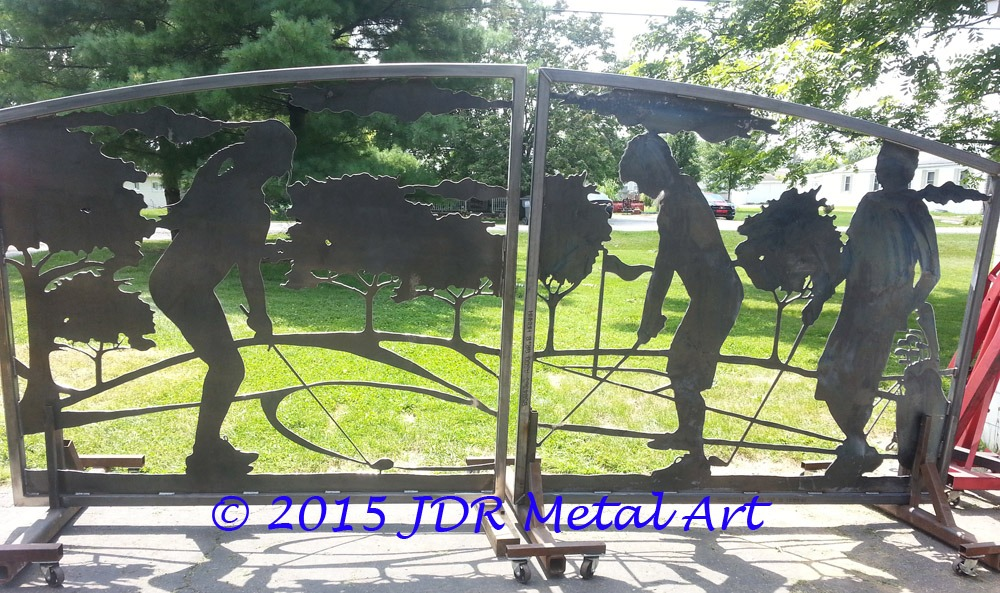 Driveway gates with silhouettes of golfers on a golf course.