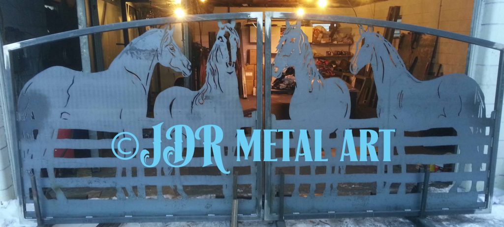Entry gate with metal art horses.