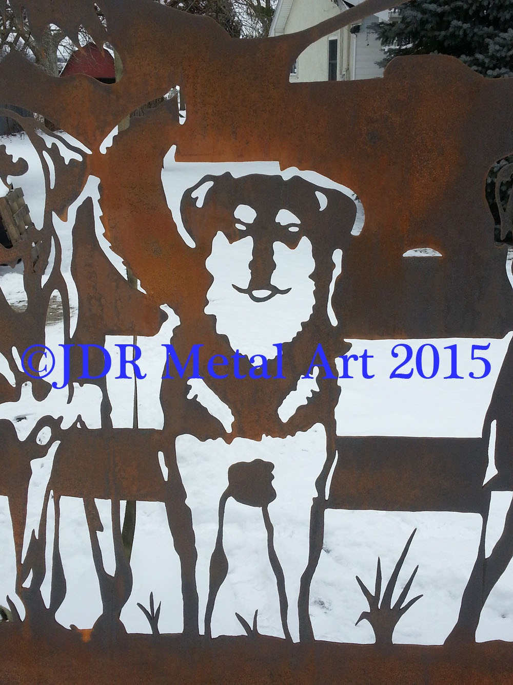 One of the five plasma cut dog silhouettes after we sprayed the steel ...