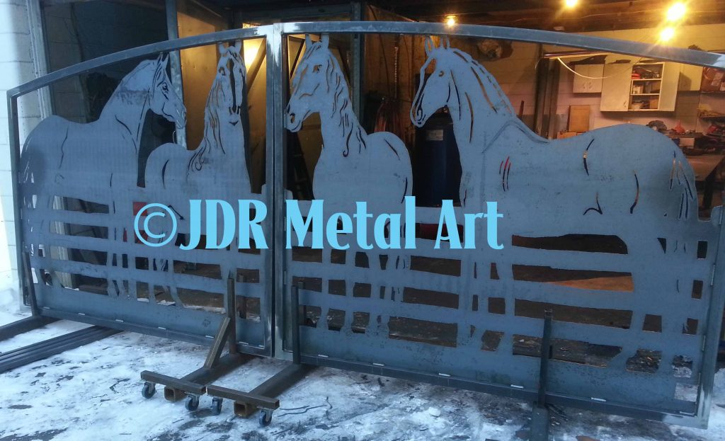 Drive gate featuring metal horse silhouettes.