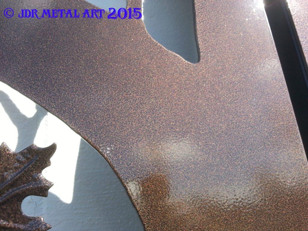 Bronze powder coat on steel driveway gate.