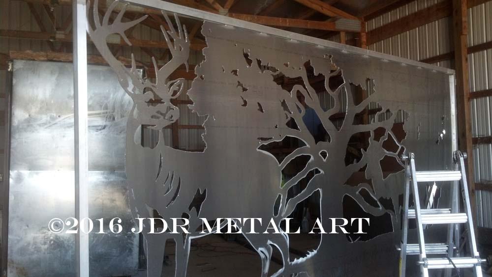 Metal art driveway gates we plasma cut from marine grade aluminum for Orlando Florida residence.