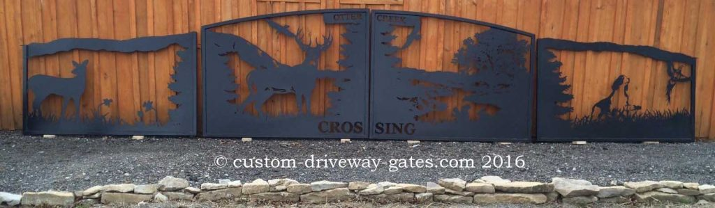 Decorative driveway gates with deer, dog and pheasant theme plasma cut for Marion Ohio drive entry.