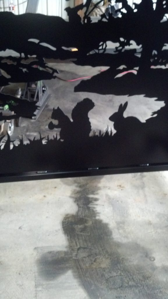 Decorative driveway gates with rabbit and squirrel silhouettes plasma cut by JDR Metal Art.