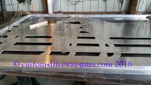 Aluminum gate design with horses for entrance after it was plasma cut by JDR Metal Art.