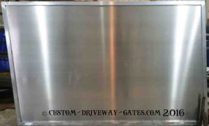 Aluminum driveway gate panel with blank sheet for privacy.