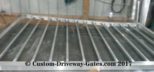 Aluminum drive gate with pickets for fancy gate