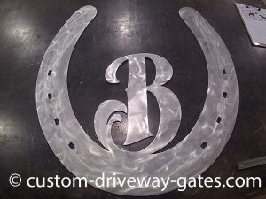 Aluminum horseshoe design cut with plasma cutter by JDR Metal Art.