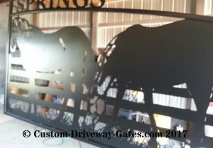 Western ranch entry gate with horses