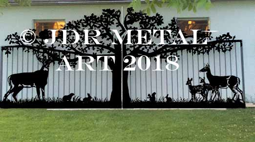Driveway gate design with tree and deer and other wildlife.