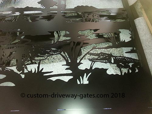 Alligator themed driveway gate silhouette