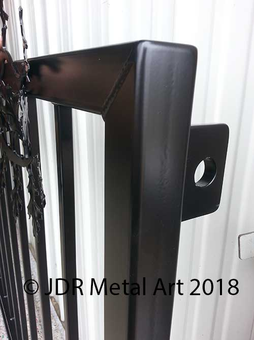 Driveway gate hinge bracket on Kansas City entry gate