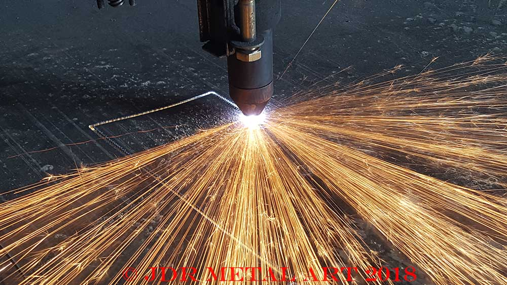 Here is a plasma cutter that is cutting a metal sheet.