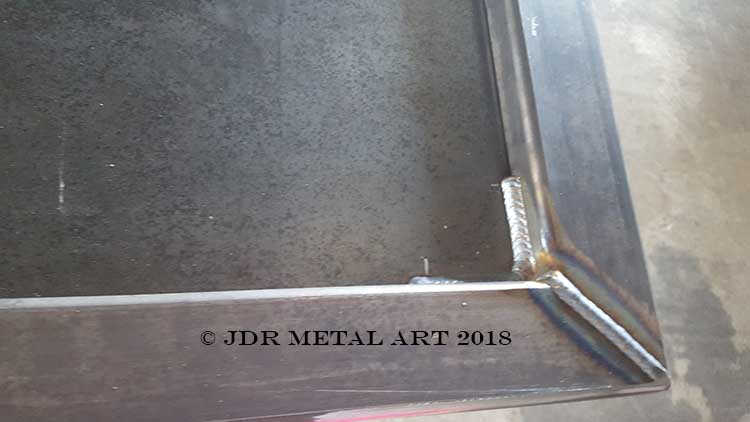 This is a custom metal art gate frame with mig welds.
