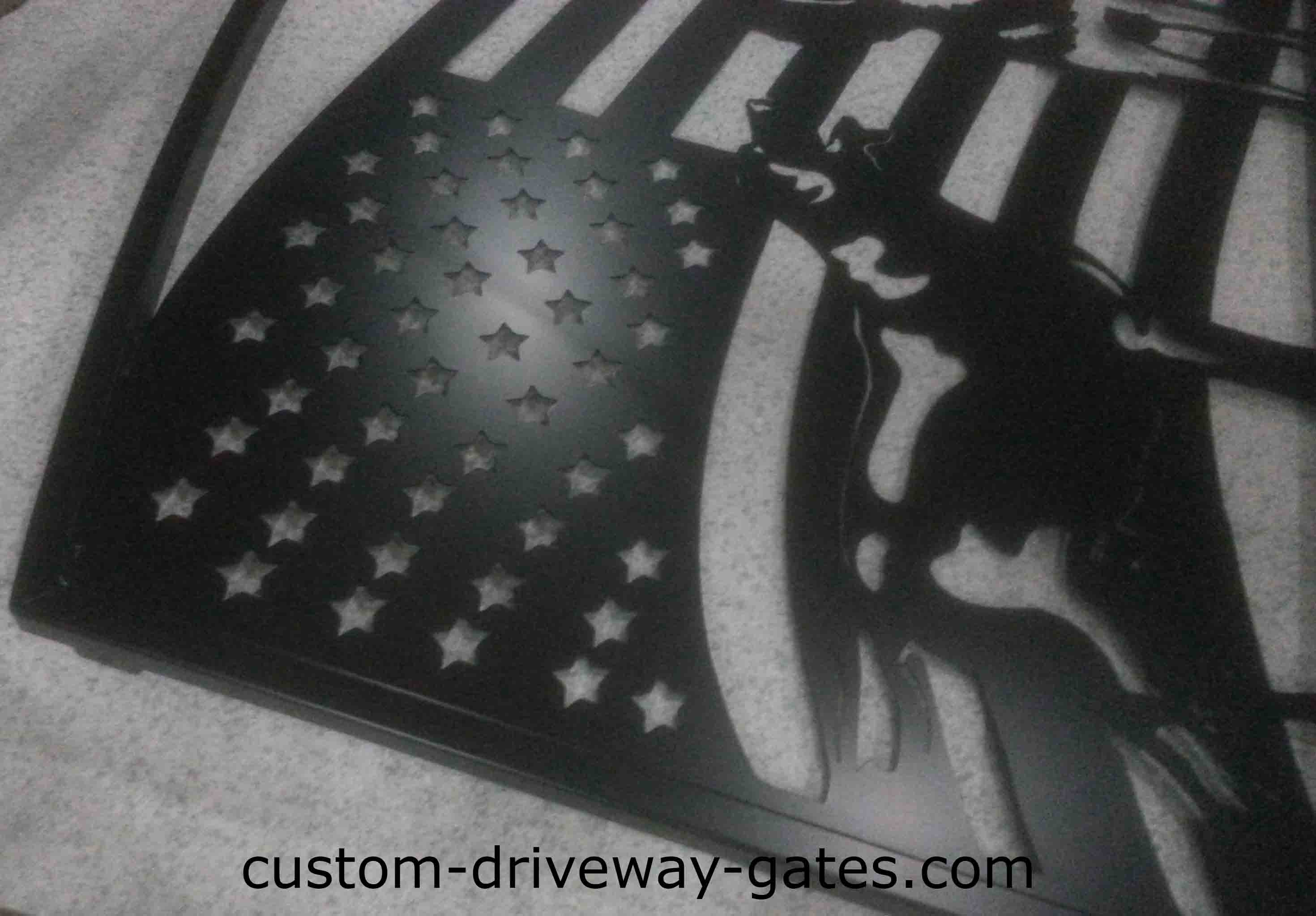 Steel single swing ornamental driveway gate with plasma cut design.