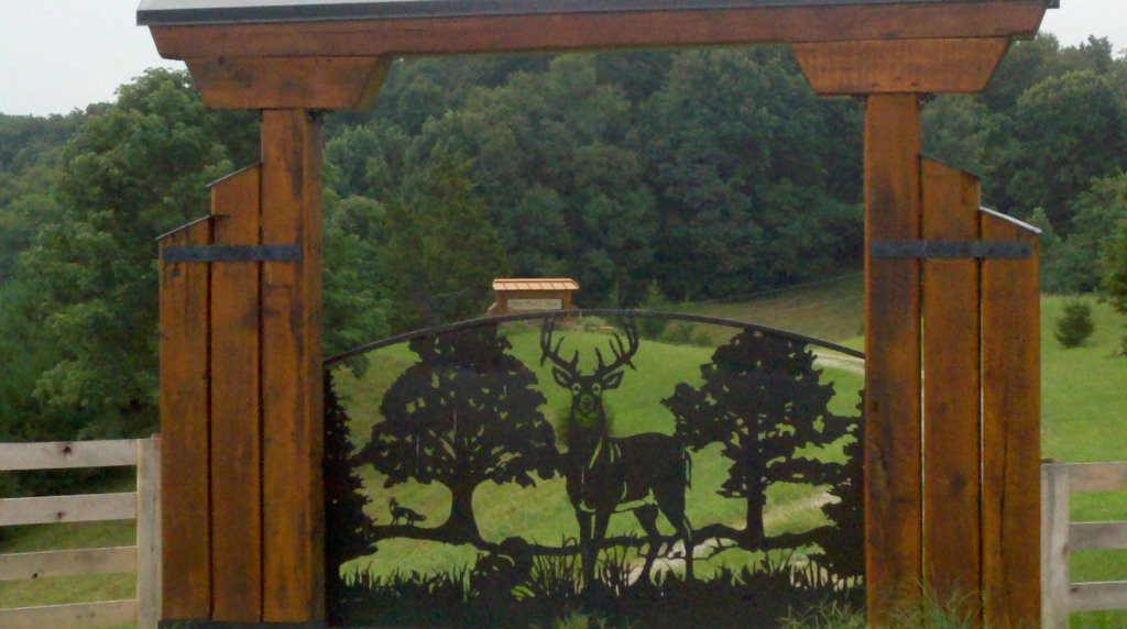 Driveway gates with custom wildlife deer silhouette design. Handcrafted from steel by JDR Metal Art.