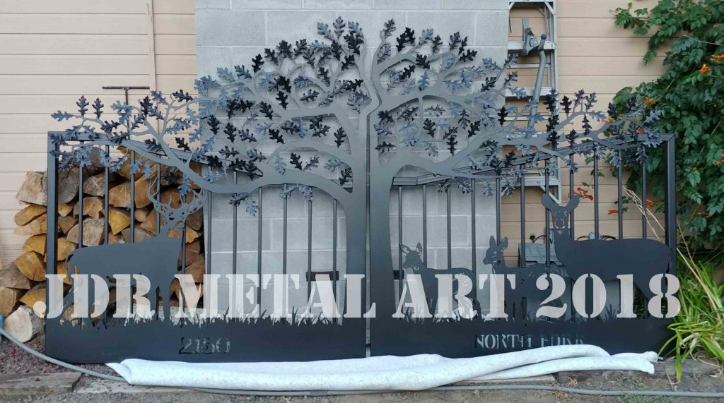 Washington decorative gates with tree and wildlife theme.