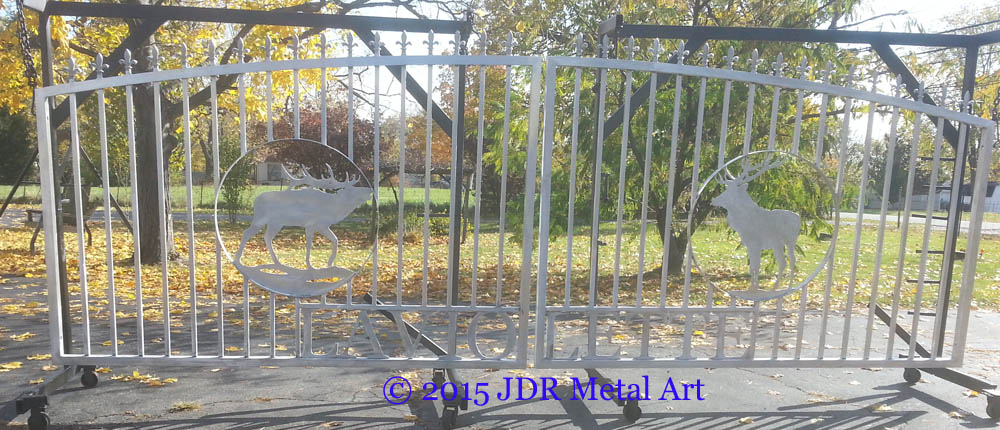 Aluminum driveway gates with pickets and spears.