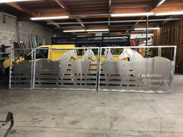 Aluminum gates with plasma cut design for Los Angeles area residence.
