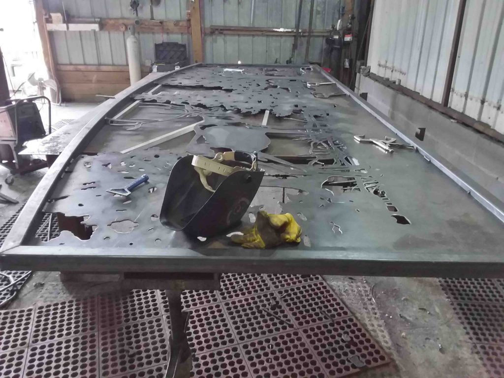 Steel driveway gates on welding table.