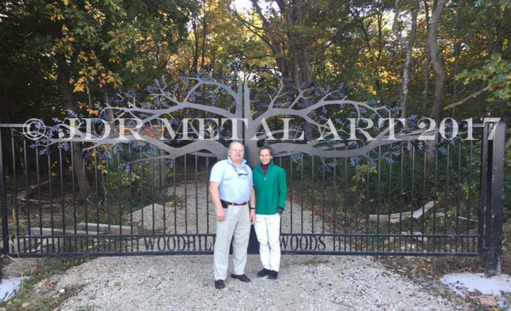 Custom driveway gates with tree design for tree farm.