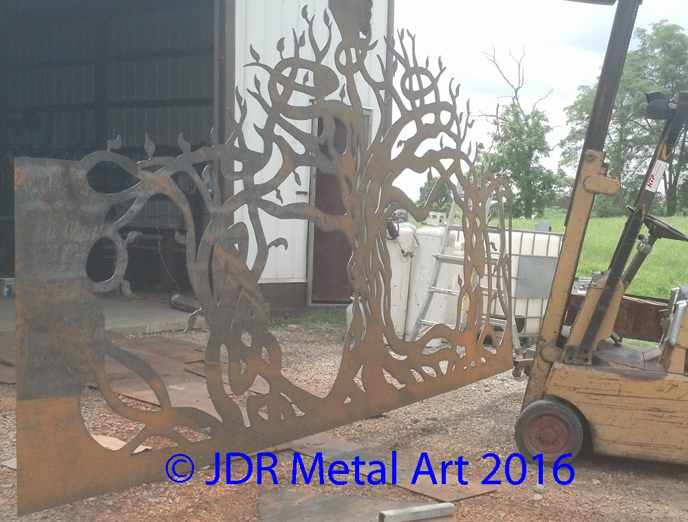 Artistic tree for estate gate being plasma cut by JDR Metal Art.