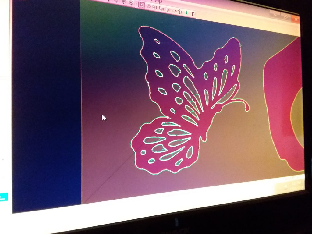 The design of a butterfly that will be plasma cut and welded onto a driveway gate.