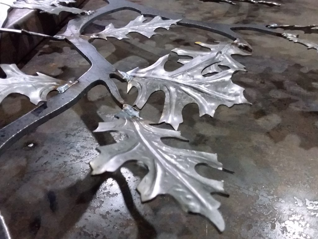 Decorative welded iron leaves.