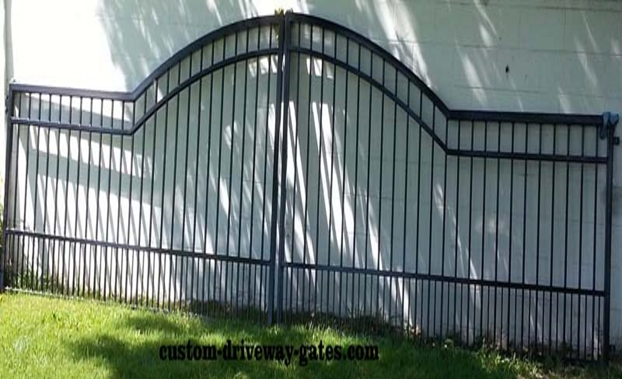 Simple ranch gates for tradition themed home.