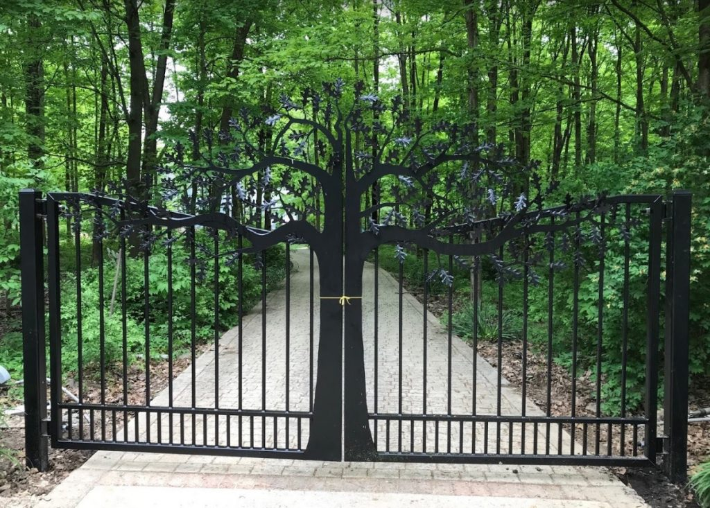 Driveway gate with tree design by JDR Metal Art.