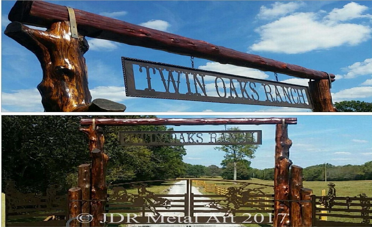 Nashville driveway gates with ranch theme, plasma cut silhouette art, a log overhead and automatic gate openers installed by JDR Metal Art.