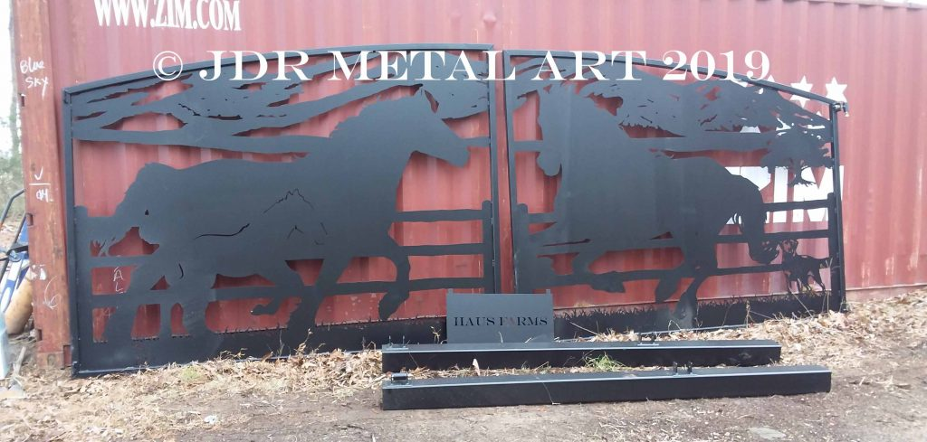 Driveway gates for North Carolina farm entrance with plasma cut horse theme.