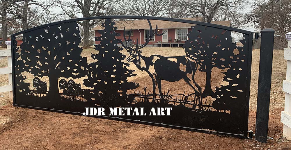 Elk driveway gate design in front of Oklahoma driveway entrance.