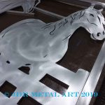 Horse farm driveway gate with plasma cut horse and fence design.