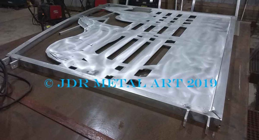 Aluminum driveway gate on welding table.
