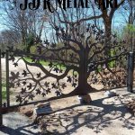 14' dual swing custom gate with maple tree design at driveway.