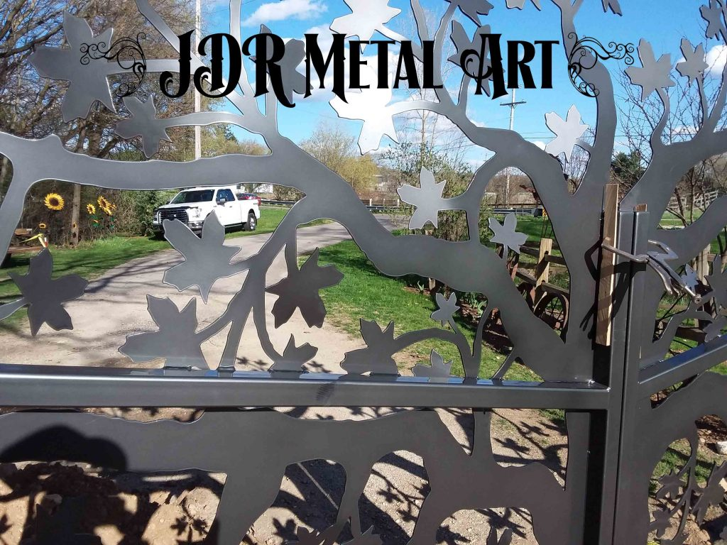 decorative driveway gate with maple tree theme