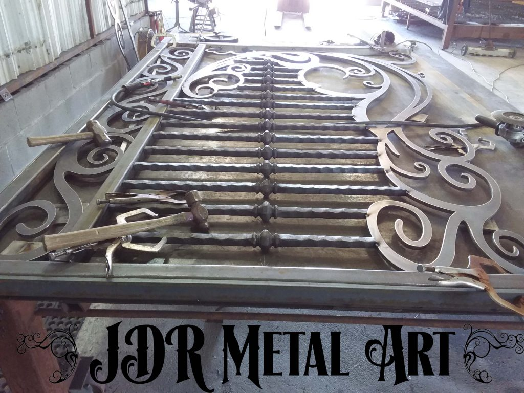 Fabrication of wrought iron and plasma cut driveway gate.
