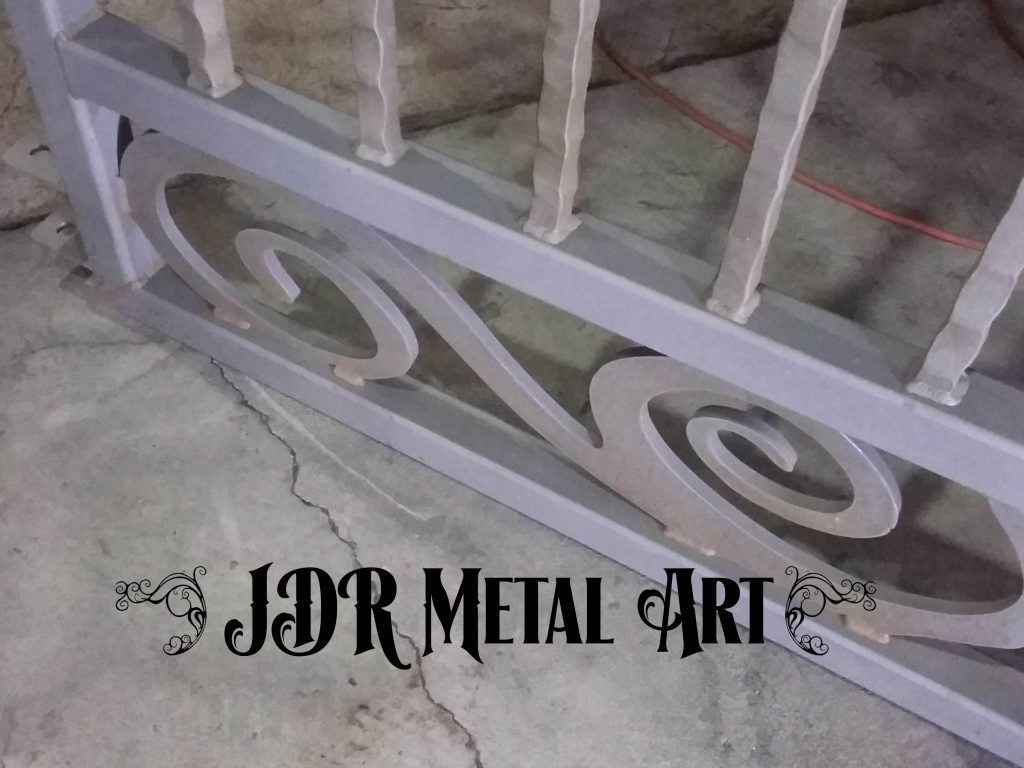 Plasma cut scrollwork, 2x2 square tubing steel and hammered wrought iron scroll.
