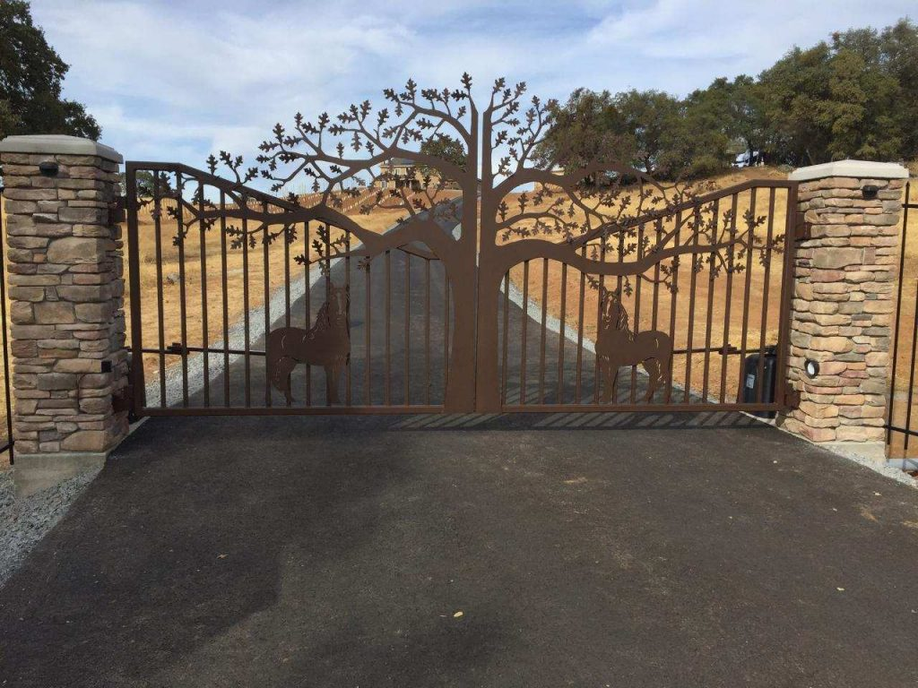 Driveway gate with trees and horses