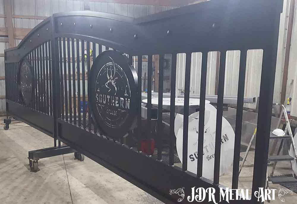 Aluminum entrance gates with black powder coat finish.