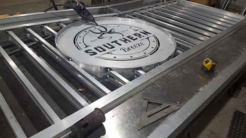 Placing the logo into a custom aluminum picket gate.