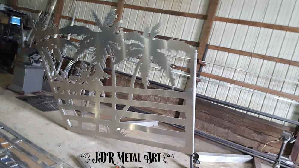 Aluminum metal art palm tree gate panel after welding.