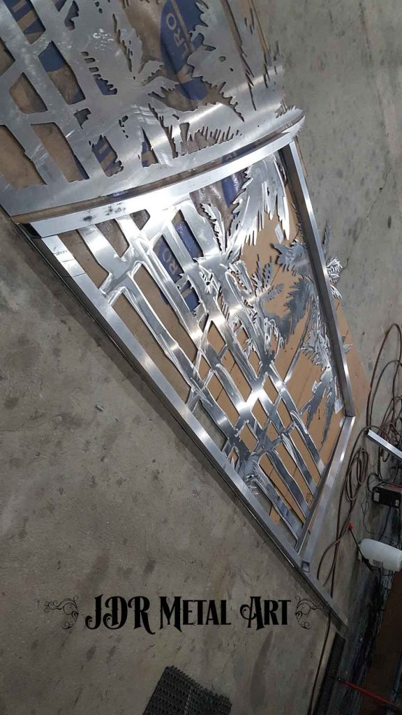 Dual swing aluminum driveway gates 16' wide during layout of frame.