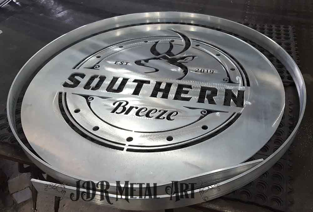 Aluminum gate design with logo being prepared for welding.